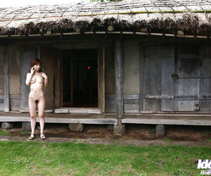 Redhead asian babe An Nanba stripping off her clothes outdoor