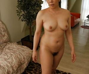 Naughty asian mature lassie with hairy twat Kimiko Yasue posing nude