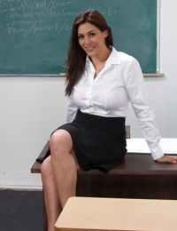 Smiley brunette teacher with gorgeous curves undressing in the classroom