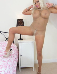Michelle Thorne is demonstrating her big tits and ass in pantyhose