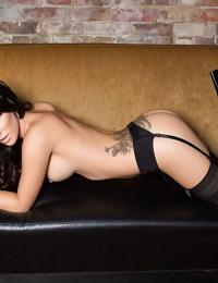Brunette centerfold babe Alyssa Bennett strutting in stockings and garter
