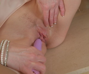 Short haired mature dame Penny Brooks using sex toy on wet pussy