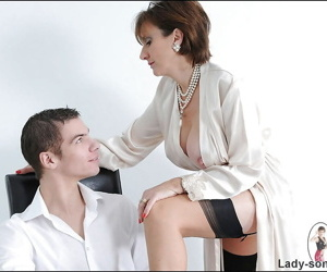 Letch mature vixen in stockings seducing a younger lad with her big tits