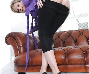 Fully clothed mature blonde lowering her tights and revealing her cunt