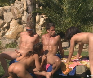 Horny couples compete with each other during sex games overlooking a lake