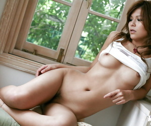 Stunning asian babe with petite ass uncovering her titties and hairy cunt