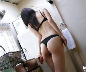 Sexy asian babe with hot legs stripping and exposing her tempting body