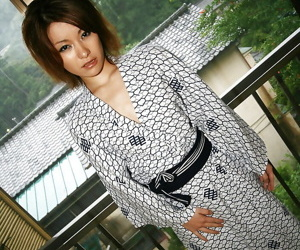 Saucy asian cutie in kimono lets a naughty guy play with her tits