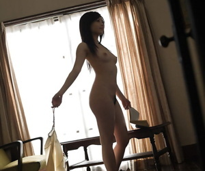 Adorable asian babe with sexy legs China Yuki slipping off her clothes