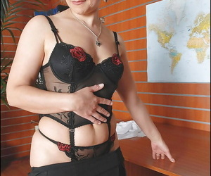 Filthy mature lady in glasses stripping off her suit in the office