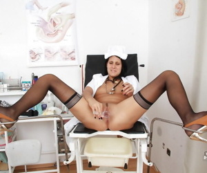 Nurse Ruby is penetrating her tight shaved hole in close-up scene