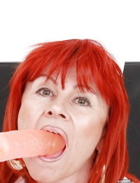 Redhead mature nurse stuffing her twat with a vibrator and gyno tools