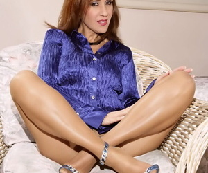 Sexy mature Roni goes topless and poses in shiny nylon pantyhose