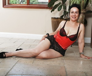 Mature brunette Miss Nina Swiss shows off her saggy tits in lingerie