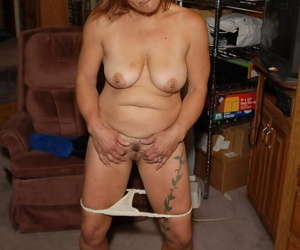 Older lady Ivee exposes tits for nipple play while masturbating