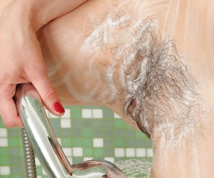 Super hot mature female Victoria pours stream of water on her bush
