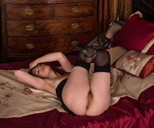 Mature cutie Mistique spreading her long legs in stockings