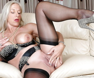 Sexy mature blonde with big tits stripping and teasing her shaved cunt