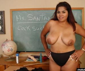Mature teacher Nikki undressing in classroom to expose huge saggy boobs