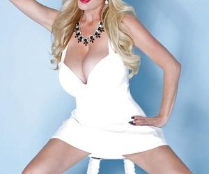 Buxom blonde Kelly Madison lets her huge knockers free from sailor uniform