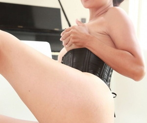 Asian MILF Dana Vespoli spreads her legs to show her pussy in black corset