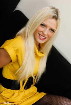 Dirty blonde girl Sophia Lee shows off hose clad feet in a black miniskirt