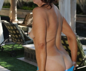 Beautiful mature Renee Black removes shorts outdoors & stretches pussy lips