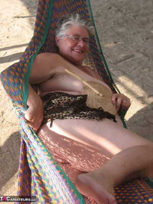 Obese nan Girdle Goddess bares her large tits and fat belly on a hammock