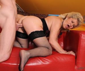 Insatiable big tit granny Effie masturbates and gets dicked on red sofa