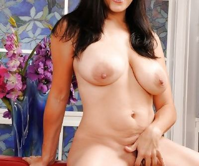 Pornstar Latina Raylene is posing and touching her natural boobies
