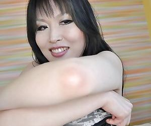 Asian MILF Kazue Yabuta stripping down and exposing her inviting cunt
