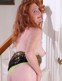 Scorching redhead granny Tami Estelle flaunts petite saggy boobs & smooth bald cunt