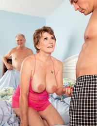 Hot granny Bea Cummins flaunts bare soles & gives hot titjob and handjob