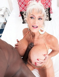 Grandma with monster boobs toying with a big ebony cock - part 2706