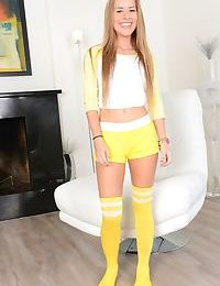Young solo girl Lily Ford bares flat chest and tight ass in yellow sport socks