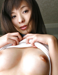 Graceful asian babe in sport garment unveiling her seductive kinks