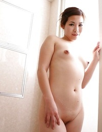 Asian MILF with shaved pussy Satoko Suda playing with massager after shower