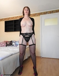 Nasty granny Kat Kitty arching to stretched ass in black blossom and heels