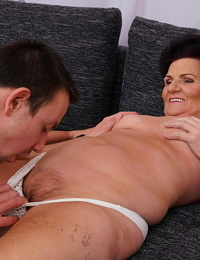Old chick kisses her fucktoy endowed before the disrobe each other on sofa