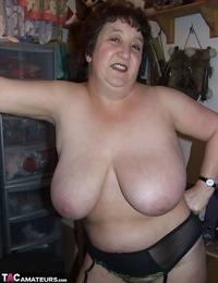 Granny Kinky Carol uncovers her thick hooters and phat nut sack in dark-hued underwear