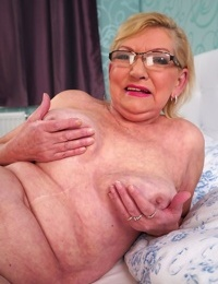 Thick grandmother Irene bares her saggy knockers before displaying her S/M muff