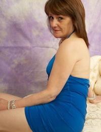 Slim scorching granny Pandora bares diminutive tits & asshole & poses on her knees