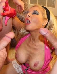 Mature slut Blondie Blow does a blowbang in pink latex and and white stockings