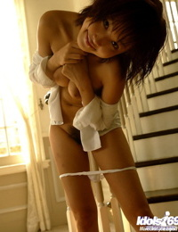 Beautiful asian cutie with shaggy muff slipping off her lingerie