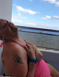 Fat nan with brief red hair finger stretches her pussy on oceanside balcony