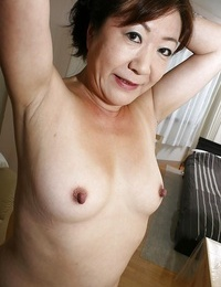 Naughty asian granny with pointy hooters and hairy cootchie taking shower